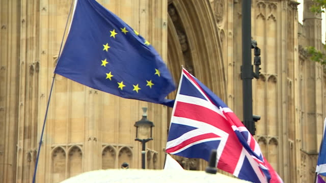 union jacks and eu flags outside the houses of parliament - brexit stock videos & royalty-free footage