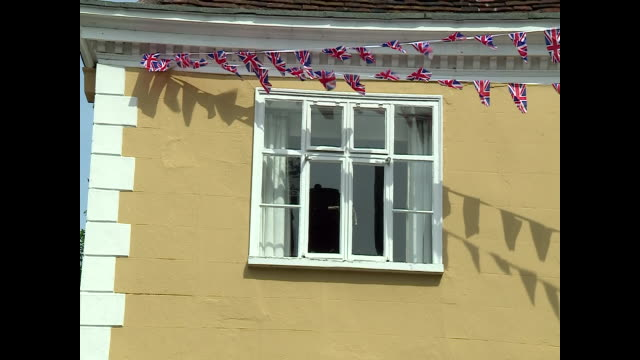 union jacks on display in dedham to celebrate ve day - national flag stock videos & royalty-free footage