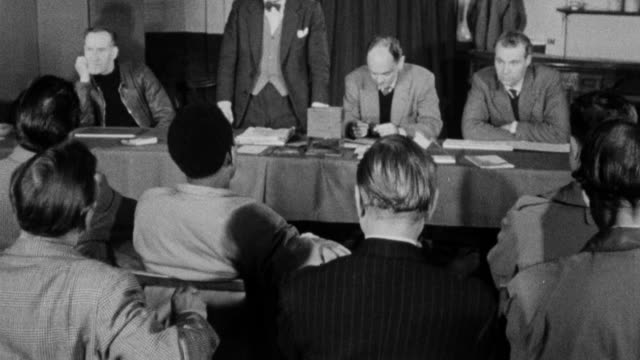 1960 montage union members discussing a resolution before it goes to a vote during a branch meeting / united kingdom - labour party stock videos & royalty-free footage
