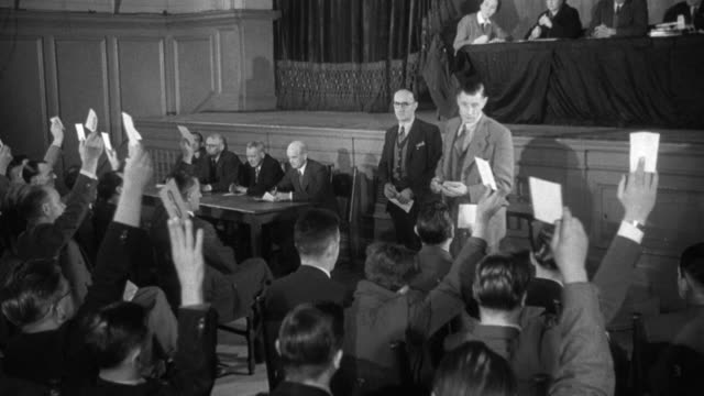 1955 montage union members participate in a vote / united kingdom - chairperson stock videos & royalty-free footage
