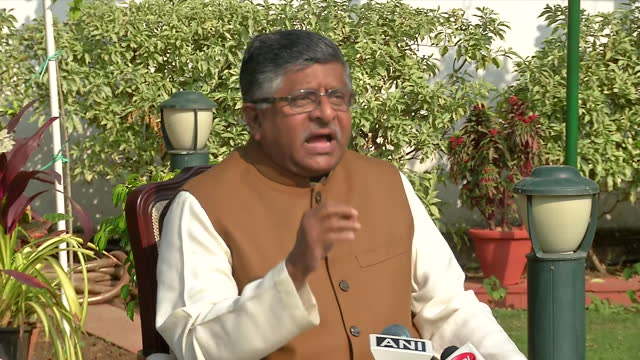 union minister ravi shankar prasad explaining how there's always a kickback involved in any kind of significant deal and scandal and how always some... - byte stock videos & royalty-free footage