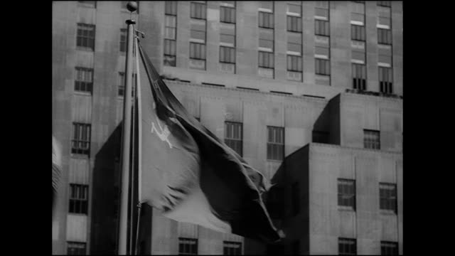 union of soviet socialist republics country flag flying on pole at top of sunken central plaza united nations member hammer sickle logo icon iconic... - communist flag stock videos and b-roll footage