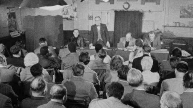 stockvideo's en b-roll-footage met 1960 b/w ha union officer calling for order during a branch meeting / united kingdom - britse labor partij