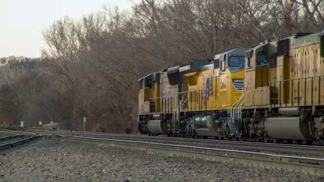 union pacific engine and train roll down the track. - omaha stock videos & royalty-free footage