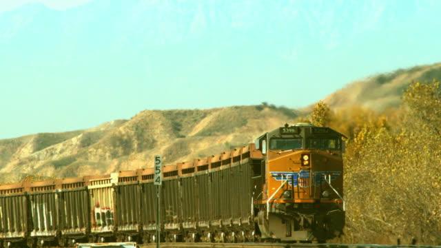 A Union Pacific freight train speeds through the California desert.