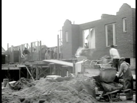 union painters painting house exterior union masons laying bricks at construction site dramatization man calling for more bricks older male telling... - 1946 stock videos and b-roll footage