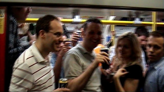 union says tube drinking parties endangered london underground workers; crowds of drinkers with bottles of wine on london underground platform men... - lager stock videos & royalty-free footage
