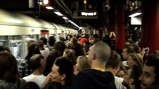 union says tube drinking parties endangered london underground workers; 31.5.2008 england: london: int revellers with cans of lager on crowded tube... - lager stock videos & royalty-free footage
