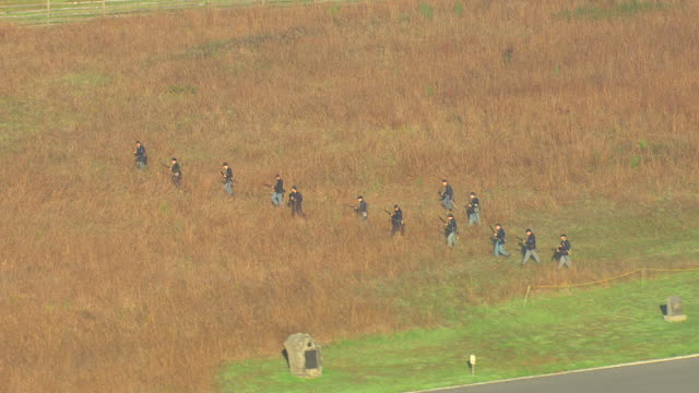ms aerial ts union soldiers reenact war in field and shooting guns at gettysburg national military park / pennsylvania, united states - civil war stock videos and b-roll footage