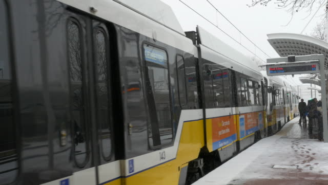 Union Station, Dallas, Texas, DART train departing station in snowstorm