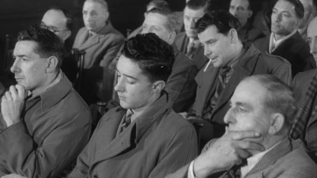 1955 pan union workers sitting and listening during a meeting / united kingdom - labor union stock videos and b-roll footage