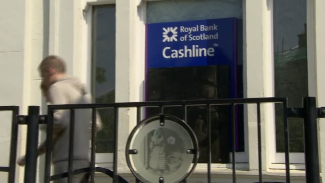unions and shareholders oppose rbs bank closures scotland lanarkshire airdrie ext red and white tape blocking entrance to rbs people along to rbs... - ロイヤル・バンク・オブ・スコットランド点の映像素材/bロール