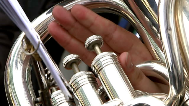 unions pay tribute to 'massive contribution' of bob crow and tony benn england london clerkenwell ext various of rmt brass band playing sot man next... - trombone stock videos & royalty-free footage