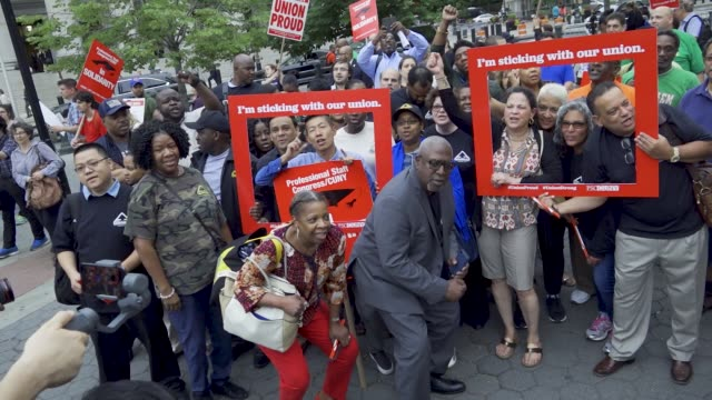 unions rallied at foley square in the civic area of downtown manhattan in opposition to the supreme court's ruling in the janus v afscme case on june... - gewerkschaft stock-videos und b-roll-filmmaterial