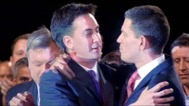 unions turn on labour leader ed miliband over spending cuts policy; lib england: int david miliband embracing brother ed miliband after results of... - trade union stock videos & royalty-free footage