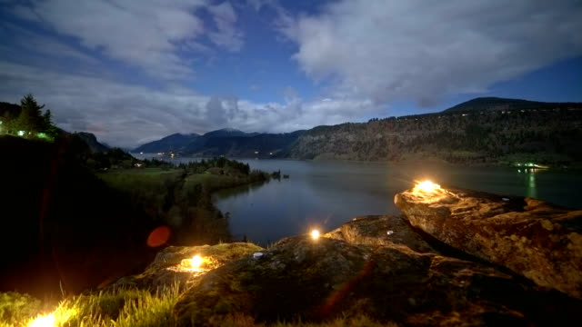 Unique candles light up the Columbia River Gorge at Night moon and stars from Hood River and I84 from Ruthton Park