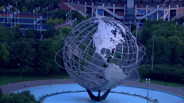 unisphere in flushing meadows park revealing partial us open stadium bg ny pavilion observation towers fg zo to xws queens bg - pavilion stock videos & royalty-free footage