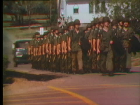 unit marches through digby, nova scotia as part of a completely voluntary military. - (war or terrorism or election or government or illness or news event or speech or politics or politician or conflict or military or extreme weather or business or economy) and not usa stock videos & royalty-free footage