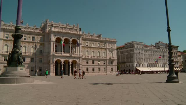 unità square in triest with people starting from prefecture palace and stratti palace the panoramic stops on the council palace - number 4 stock videos & royalty-free footage