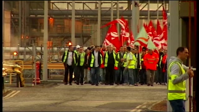 unite members reject pay and conditions deal at grangemouth refinery t27040801 / tx various shots workers on strike with unite flags waking towards... - polyethylene stock videos and b-roll footage