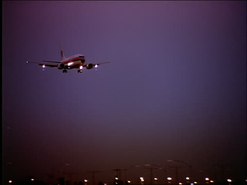 pan united airlines plane landing at los angeles airport at twilight - cinematography stock videos & royalty-free footage