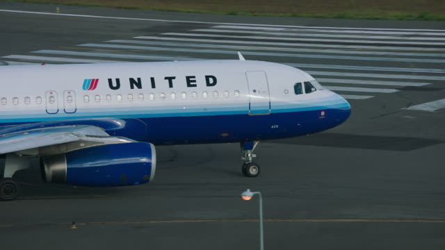 ws ts united airlines plane taxiing on taxiway in airport / st. maarten - taxiway stock videos & royalty-free footage