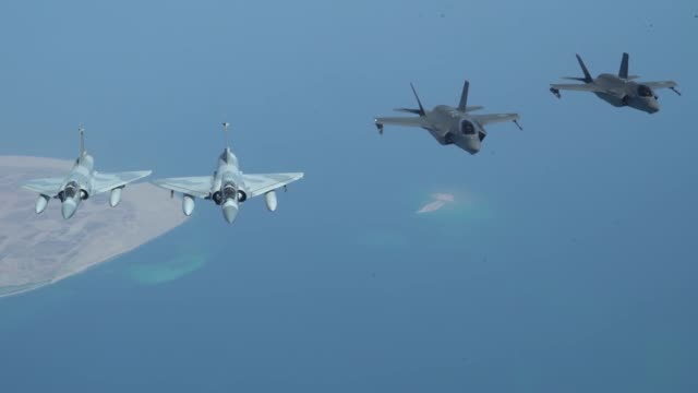a united arab emirates air force mirage 2000 a uae f16 desert falcon and a us f35a lightning ii fly a partnering flight in the us central command... - refuelling stock videos & royalty-free footage