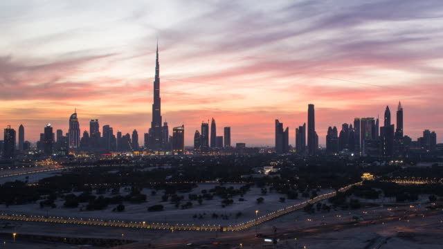 United Arab Emirates, Dubai, elevated Time lapse of the new Dubai skyline, the Burj Khalifa, modern architecture and skyscrappers on Sheikh Zayed Road