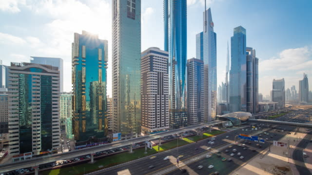 united arab emirates, dubai, elevated time lapse of the new dubai skyline, modern architecture and skyscrappers on sheikh zayed road - financial district stock videos & royalty-free footage