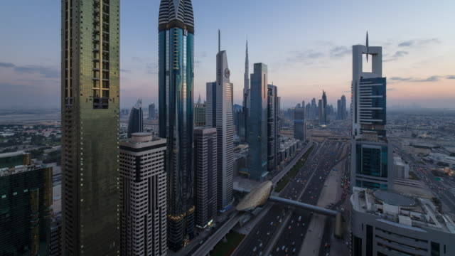 united arab emirates, dubai, elevated time lapse of the new dubai skyline, modern architecture and skyscrappers on sheikh zayed road - day to night stock videos & royalty-free footage