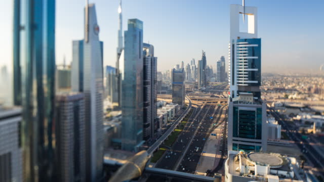 United Arab Emirates, Dubai, elevated time lapse of the new Dubai skyline, modern architecture and skyscrappers on Sheikh Zayed Road