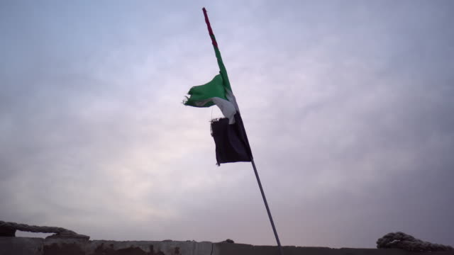 United Arab Emirates flag at sunset, low angle