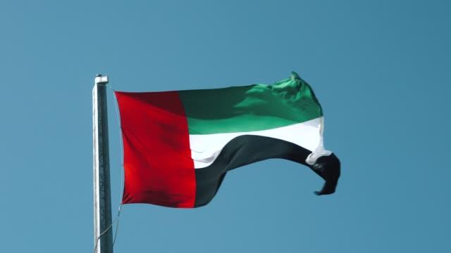 united arab emirates flag waving against clear sky - national landmark stock videos & royalty-free footage