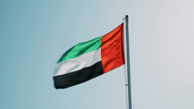 united arab emirates flag waving against clear sky - national landmark stock videos & royalty-free footage
