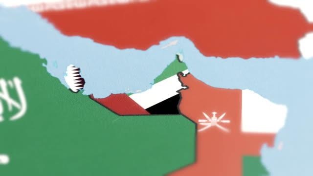 united arab emirates, qatar borders wiht national flag on world map - basra stock videos & royalty-free footage