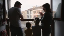United family clapping in the window