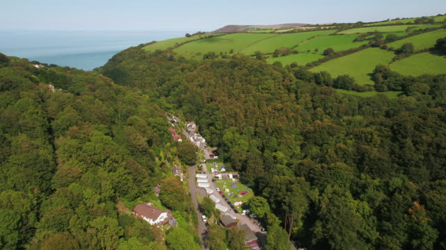 united kingdom, devon, exmoor, lynton, wooded valley on the north devon coast - valley stock videos & royalty-free footage