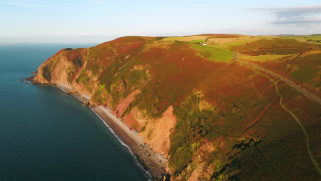 united kingdom, devon, exmoor national park, countisbury hill and foreland point with sillery sands below - devon stock videos & royalty-free footage