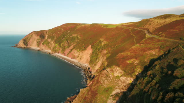 united kingdom, devon, exmoor national park, countisbury hill and foreland point with sillery sands below - exmoor national park stock videos & royalty-free footage