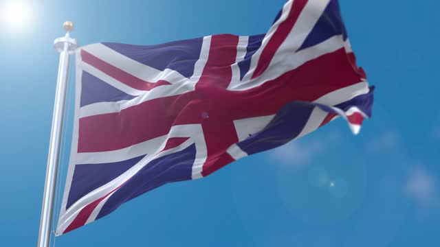 united kingdom flag flowing in the wind - uk flag stock videos & royalty-free footage