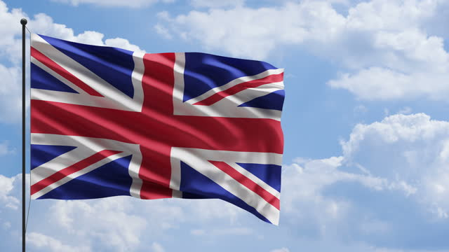 uk united kingdom flag im windkonzept mit himmel und wolken - british military stock-videos und b-roll-filmmaterial