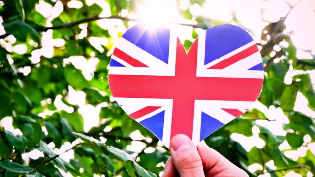 united kingdom flag on heart shape - union jack stock videos & royalty-free footage