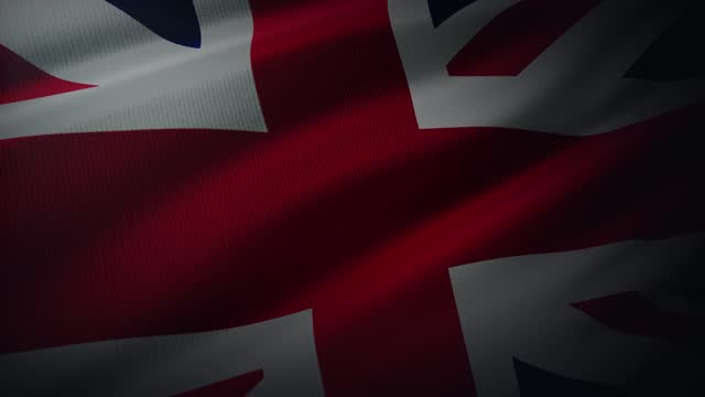 4k united kingdom flag waving in the wind with highly detailed fabric texture - world politics stock videos & royalty-free footage