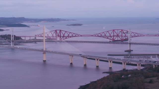 united kingdom, scotland, lothian, rail and road bridges over the firth of forth, linking south and north queensferry near edinburgh - firth of forth stock videos & royalty-free footage