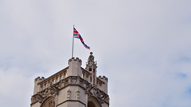 united kingdoms flag at building - union jack stock videos & royalty-free footage
