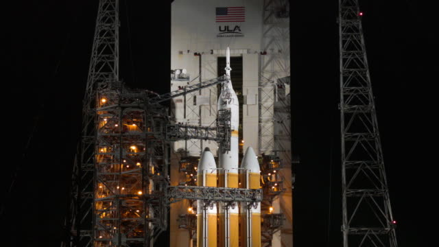 a united launch alliance delta 4 rocket carrying nasa's first orion deep space exploration craft sits on its launch pad as it is prepared for a 705... - splashdown stock videos and b-roll footage