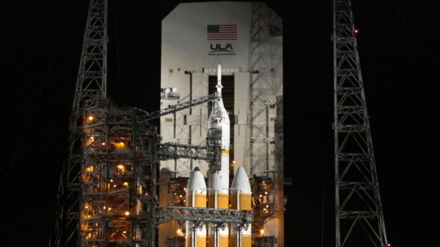 a united launch alliance delta 4 rocket carrying nasa's first orion deep space exploration craft sits on its launch pad as it is prepared for a 705... - the morning after stock videos & royalty-free footage