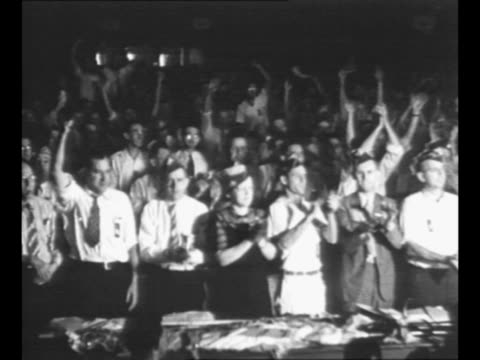cu united mine workers president john l lewis in early 1920s / crowd of workers stands applauds at meeting / lewis and two other men round corner... - 1910 1919 stock-videos und b-roll-filmmaterial