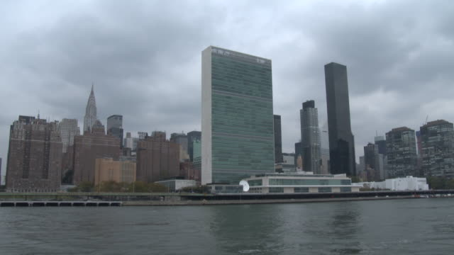 united nations building - east river nyc - united nations building stock videos and b-roll footage