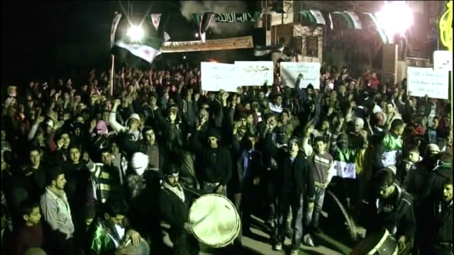 United Nations calls for President Assad to step down T13021213 Protesters gathered in town square for peaceful demonstration banging drums and...